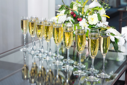 Elegant glasses with champagne standing in a row on table during party